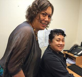 West Fono Health Trust Senior Manager Services Sally Dalhousie discusses the results of the clinic's cervical screening initiative with health care assistant Aivi Puloka.